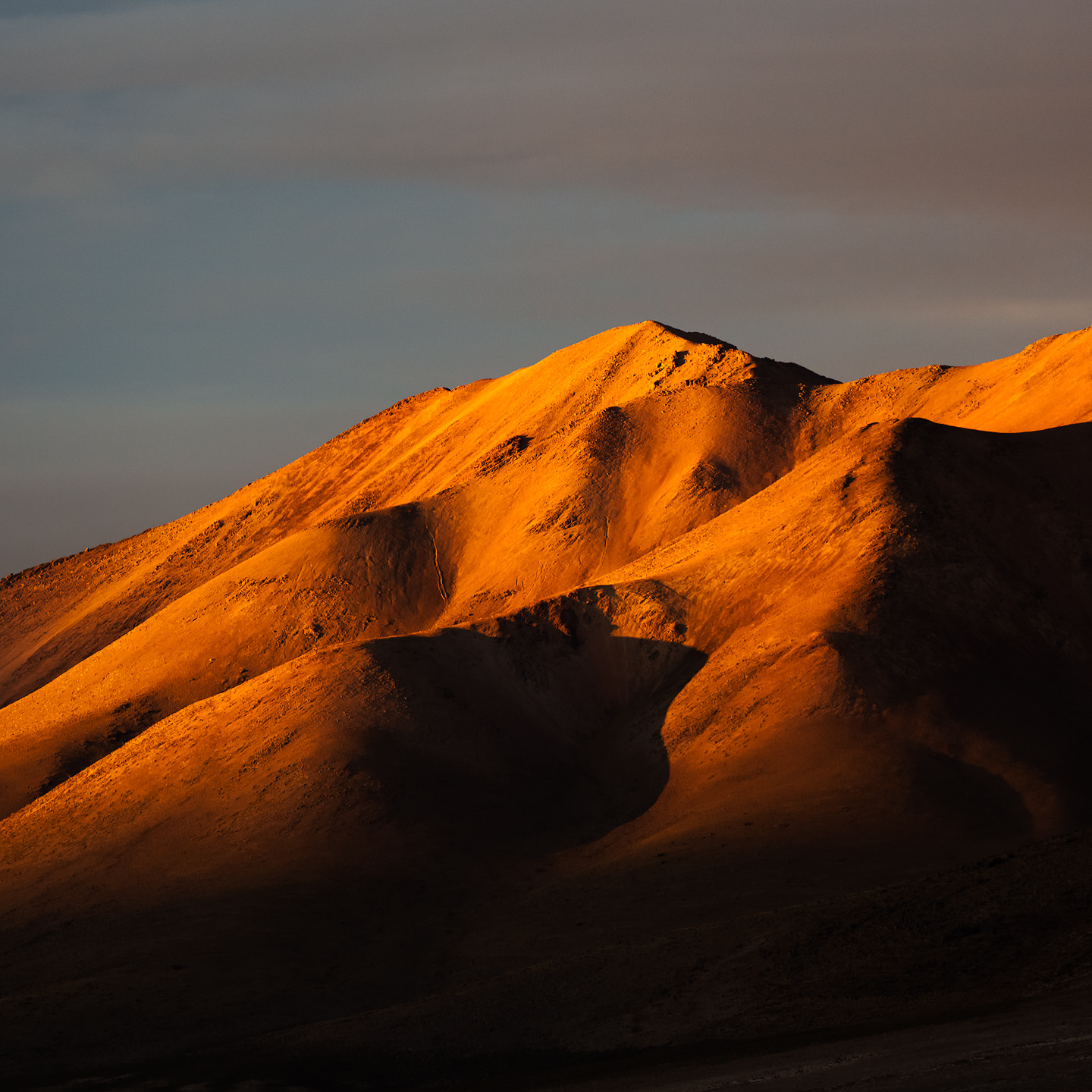 Sunset light hitting distand hills.