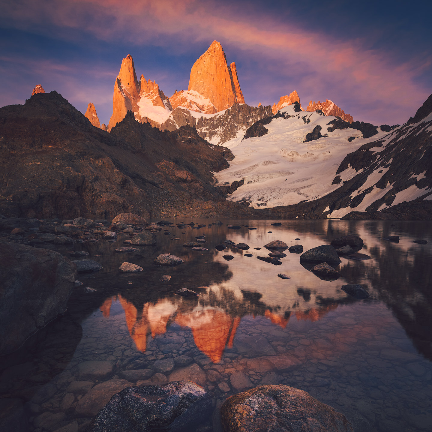 Fitz Roy reflected in Laguna de los Tres at sunrise.