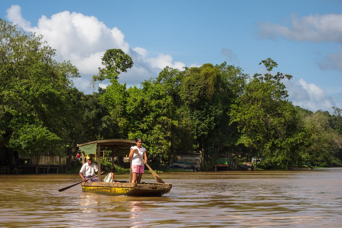 Locals use a small boat to row across the Rio San Juan.