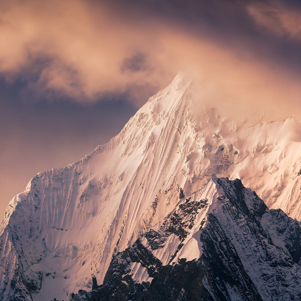Sunset light on a mountain in Cordillera Huayhuash.