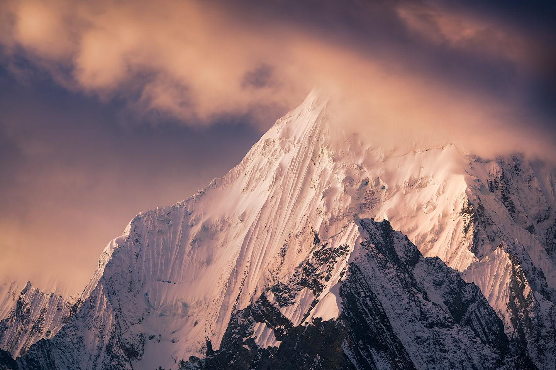 Sunset light on a mountain in Cordillera Huayhuash.